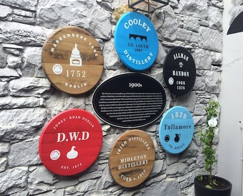 SIgns made from old Whiskey Barrels